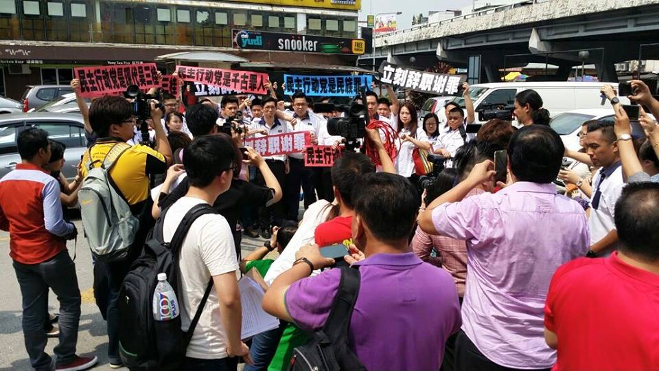 MCA Youth gathered in front of DAP HQ at Jalan Yew here today
