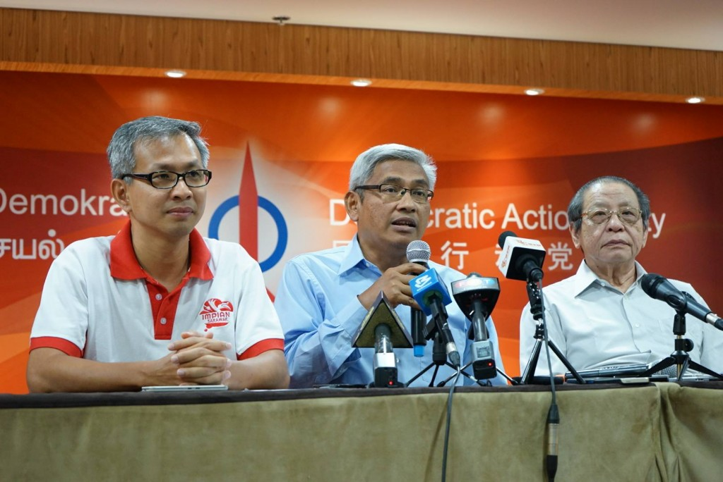Aziz (centre) said he has come to realise DAP's efficiency and meritocracy, at a press conference with DAP leaders Lim Kit Siang (right) and Tony Pua (left)